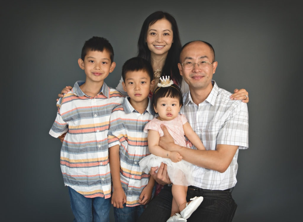 PIcture of family of 5 in front of grey backdrop