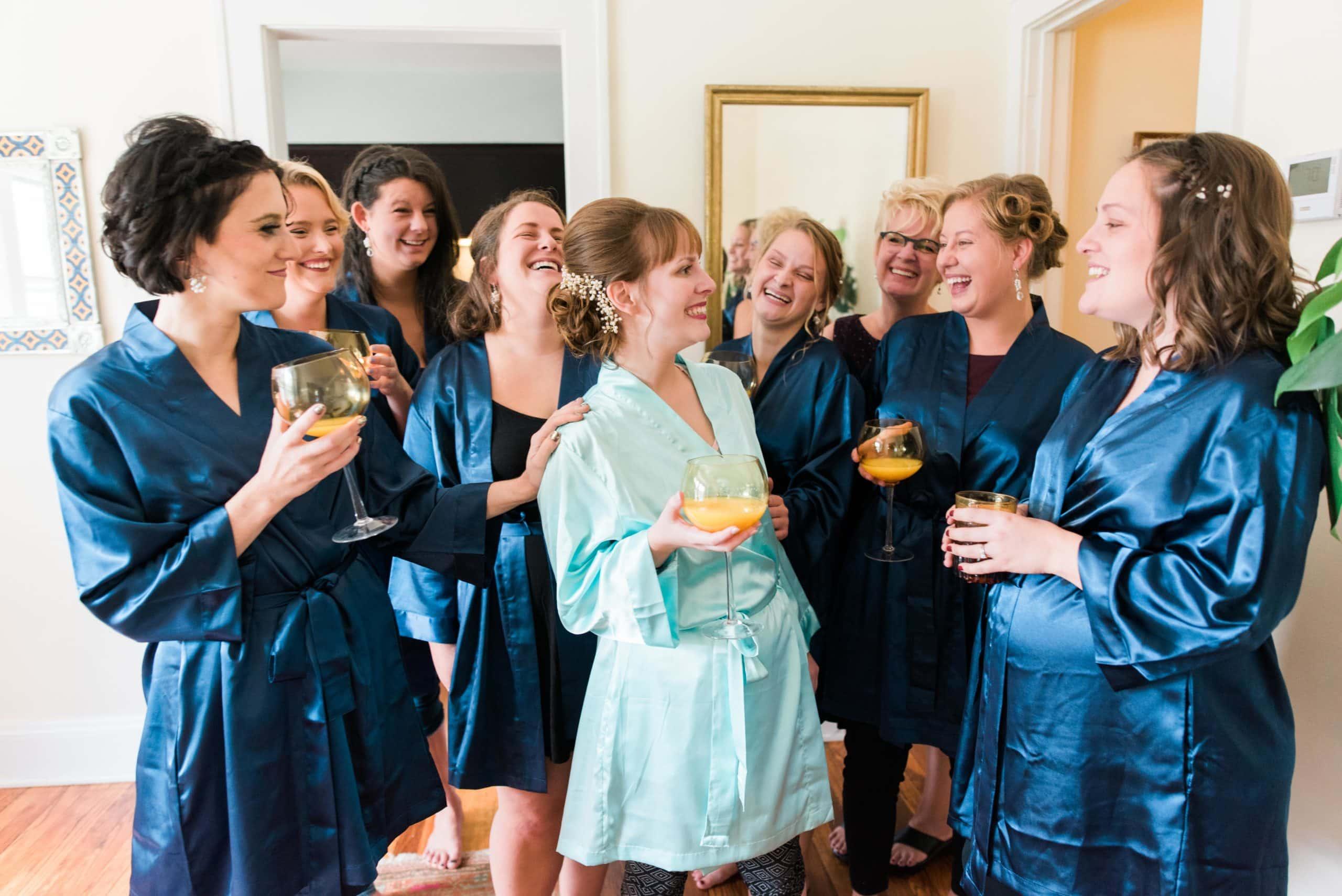 Bride & bridesmaid wearing navy blue robes